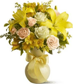 Mixed flower bouquet in sunny colors with roses, lilies and alstroemerias